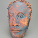 Woman of color, Healing from shame, ceramic relief, head and face sculpture, wall hung, indoor, outdoor