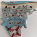 Dreamwork, Lifeguard, drowning, Healing from shame, ceramic relief, head and face sculpture, wall hung, indoor, outdoor